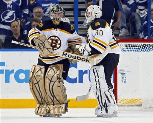 Boston Bruins goalie Marty Turco, left, is replaced in goal by Tim Thomas during the first period of an NHL hockey game against the Tampa Bay Lightning on Tuesday, March 13, 2012, in Tampa, Fla. (AP Photo/Mike Carlson)