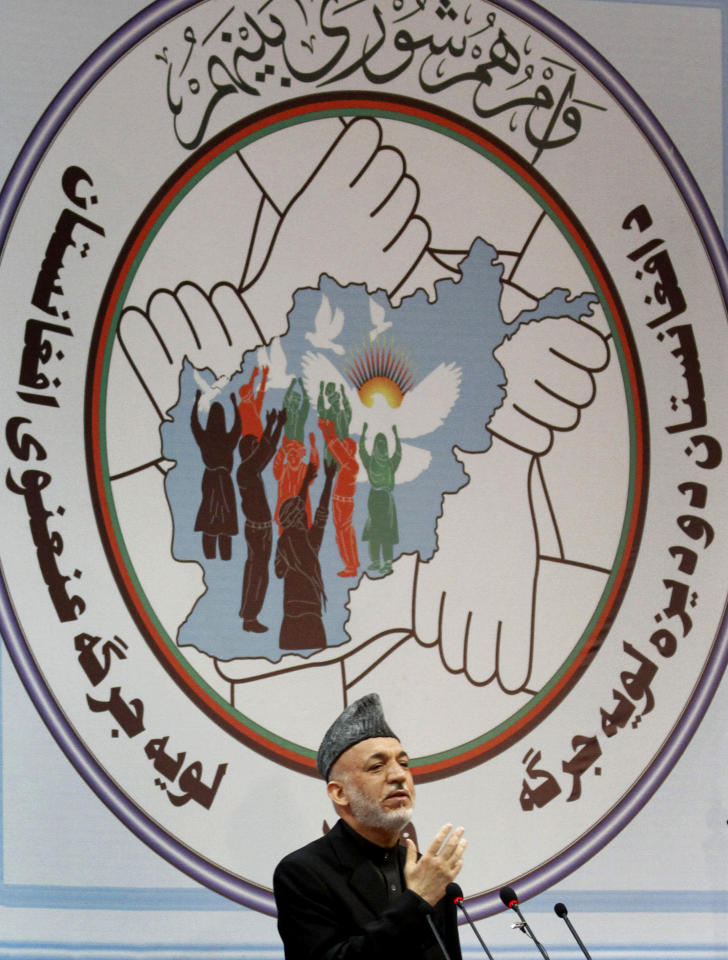 "ALTERNATIVE CROP Afghan President Hamid Karzai delivers a speech during the opening of the ""loya jirga,"" or grand council in Kabul, Afghanistan, Wednesday, Nov. 16, 2011. Afghan President Hamid Karzai called Wednesday on elders assembled for a national conference to help create a fair framework for relations with the U.S. and find a path to peace for the turbulent country.(AP Photo/Musadeq Sadeq)"