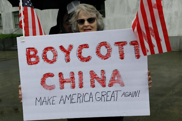 A demonstrator holds a sign reading 'Boycott China' during the protest at the State Capitol in Salem, Oregon, United States on 2 May. (John Rudoff/Anadolu Agency via Getty Images)