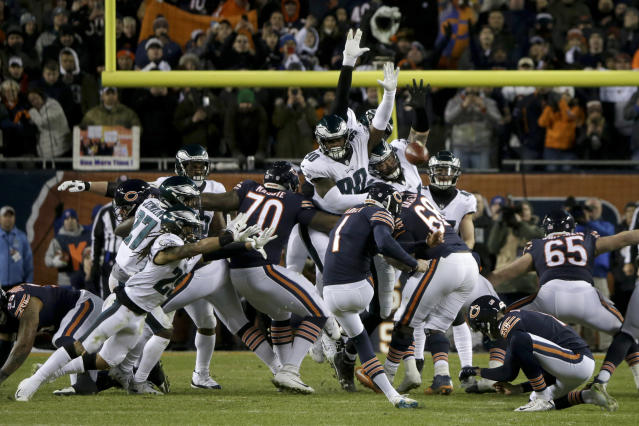 """The Eagles' <a class=""""link rapid-noclick-resp"""" href=""""/nfl/players/30357/"""" data-ylk=""""slk:Treyvon Hester"""">Treyvon Hester</a> (90) got enough of his hand on <a class=""""link rapid-noclick-resp"""" href=""""/nfl/players/27911/"""" data-ylk=""""slk:Cody Parkey"""">Cody Parkey</a>'s kick to become a lifetime hero in Philadelphia. (AP)"""