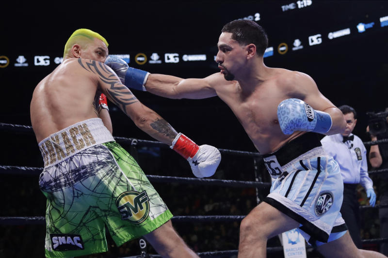 Danny Garcia punches Ukraine's Ivan Redkach during the second round of a welterweight boxing match Saturday, Jan. 25, 2020, in New York. Fulton won the fight. Hurd won the fight. (AP Photo/Frank Franklin II)