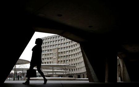 A pedestrian passes the Department of Housing and Urban Developement at the start of the third day of a shut down of the federal government in Washington, U.S., January 22, 2018.      REUTERS/Joshua Roberts