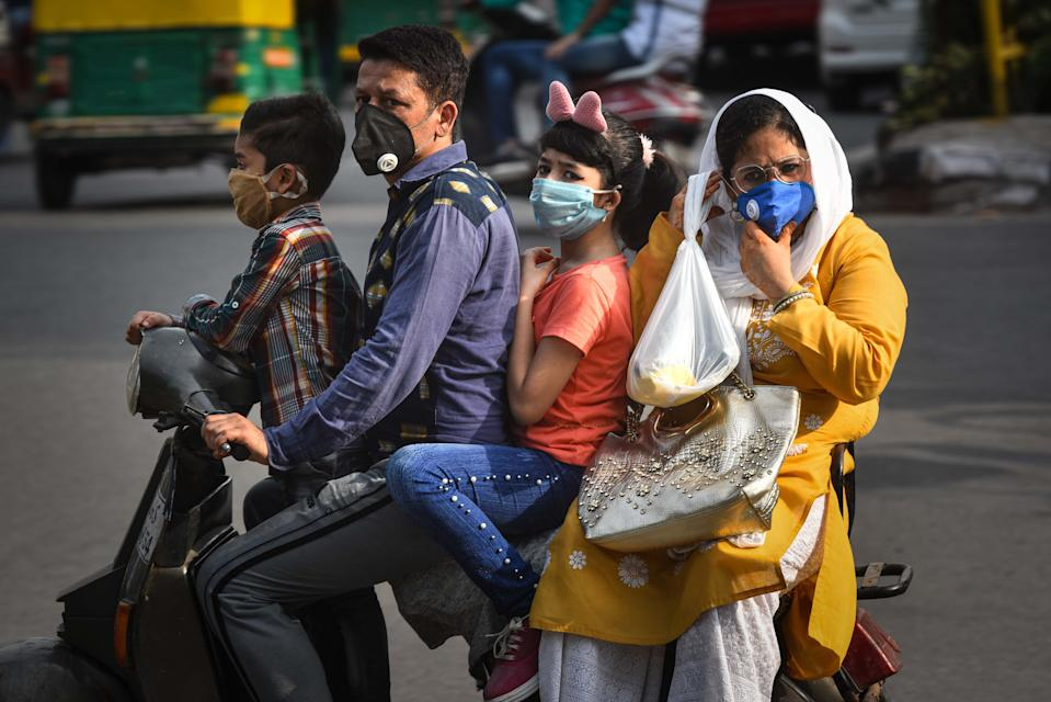 <strong>Just masks won't do, helmets save lives too.</strong> (Photo by Sanchit Khanna/Hindustan Times via Getty Images)