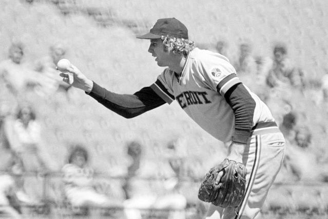 "FILE - In this June 20, 1976, file photo, Detroit Tigers' Mark ""The Bird"" Fidrych displays his unique approach to pitching, against the Minnesota Twins, in Bloomington, Minn. Ben Walker and his parents would drive up to see the Baltimore Orioles if they were playing Detroit, and Fidrych was playing. (AP Photo/File)"