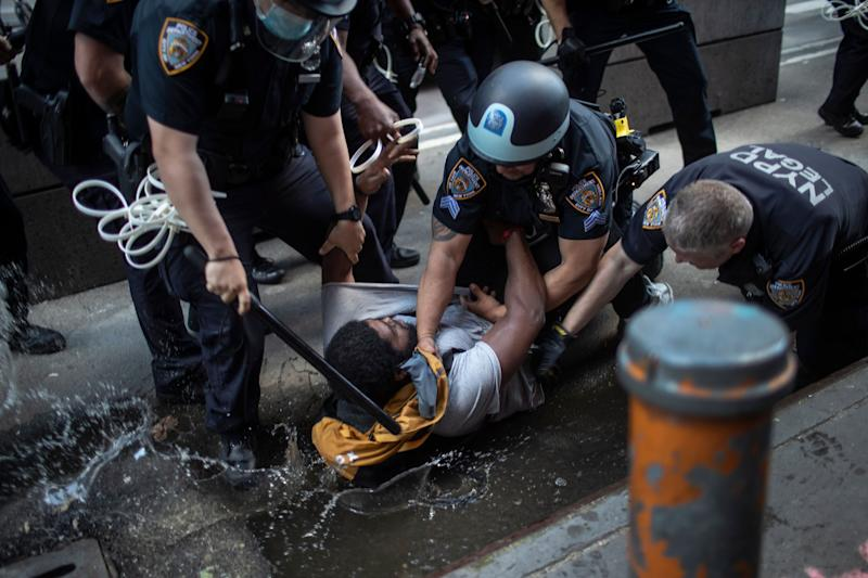 Police arrest a protester during a solidarity rally for George Floyd on May 30, 2020 in New York. Protests were held throughout the city over the death of George Floyd, a Black man who was in police custody in Minneapolis.