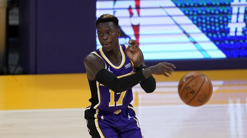 Los Angeles Lakers guard Dennis Schroder (17) passes the ball during the first quarter of an NBA basketball game against the New Orleans Pelicans Friday, Jan. 15, 2021, in Los Angeles. (AP Photo/Ashley Landis)