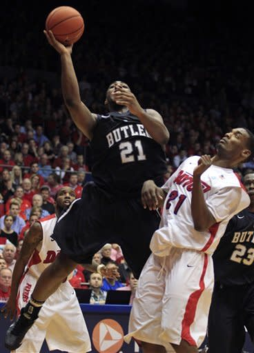 Butler's Roosevelt Jones left, shoots over Dayton's Dyshawn Pierre, right, during the second half of an NCAA college basketball game, Saturday, Jan. 12, 2013, in Dayton, Ohio. Butler won 79-73. (AP Photo/Skip Peterson)