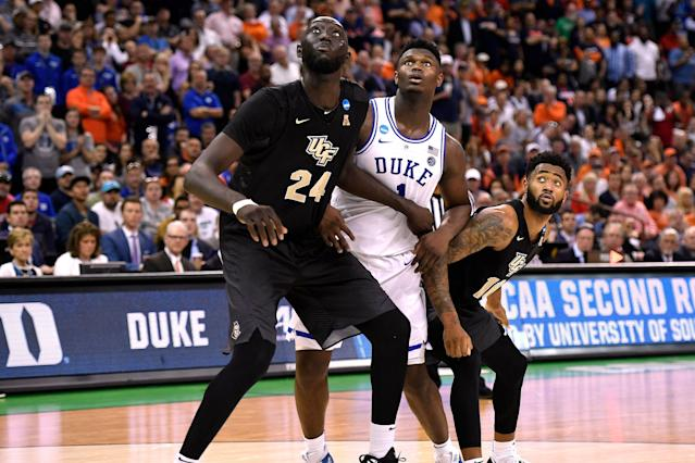UCF's Tacko Fall boxes out Duke's Zion Williamson during their 2019 NCAA tournament game. (Getty)