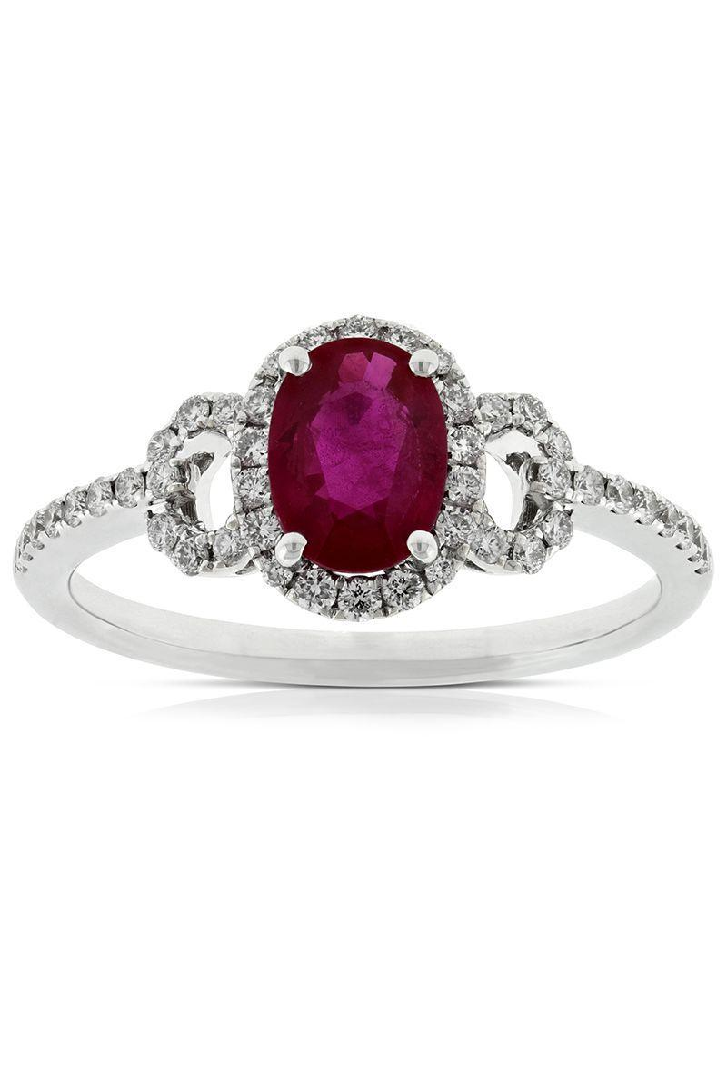 "<p>Peek-a-boo circlets of pavé diamonds with negative space in the center give the illusion of side stones and offer an added dose of sparkle and substance—without breaking the bank.<br></p><p><em>Ruby and diamond engagement ring in 14K white gold, $2,299, benbridge.com.</em></p><p><a class=""link rapid-noclick-resp"" href=""https://www.benbridge.com/jewelry/ruby-diamond-ring-14k-11508769.html#q=ruby+ring&start=1"" rel=""nofollow noopener"" target=""_blank"" data-ylk=""slk:SHOP"">SHOP</a></p>"