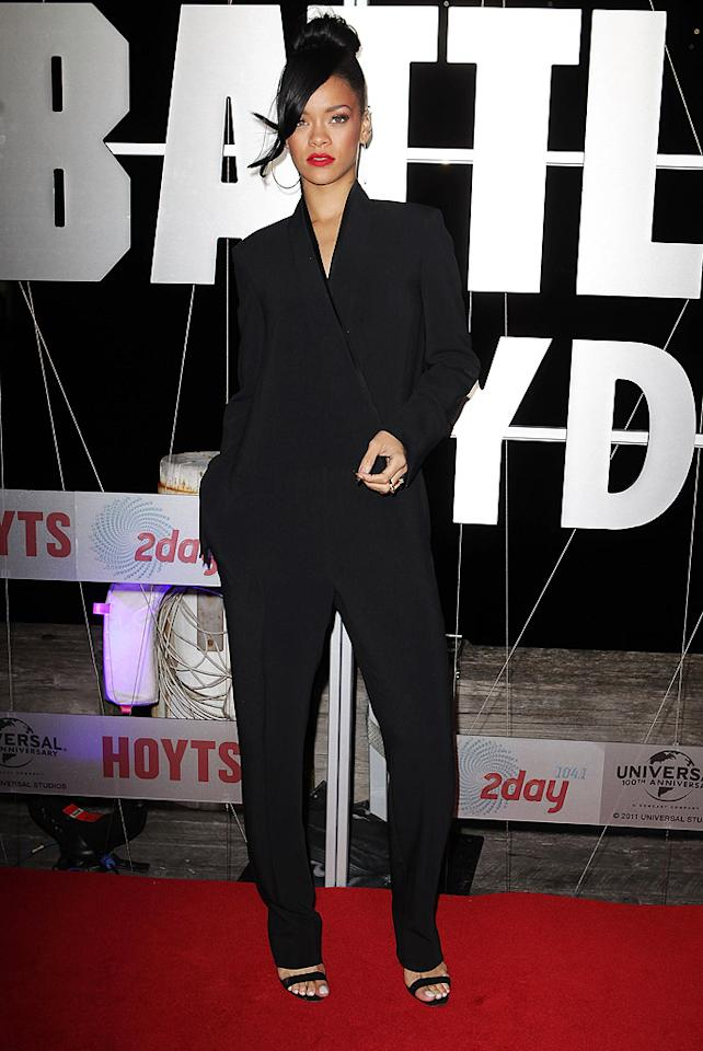 """Last week <a target=""""_blank"""" href=""""http://omg.yahoo.com/blogs/runway/rihanna-struts-her-stuff-pajama-inspired-look-battleship-173428642.html"""">Rihanna wore a polarizing, pajama-like look</a> to the Japanese premiere of <a target=""""_blank"""" href=""""http://movies.yahoo.com/movie/battleship-2012/"""">""""Battleship,""""</a> and this week, she donned an equally debatable ensemble while promoting the soon-to-be blockbuster in Sydney. The pop star -- who makes her acting debut in the action flick -- sported a tuxedo-inspired Stella McCartney jumpsuit and matching black Manolo Blahnik sandals, which we happen to love. What do you make of RiRi's trendy outfit and loose updo? Hot or not? (4/10/2012)"""