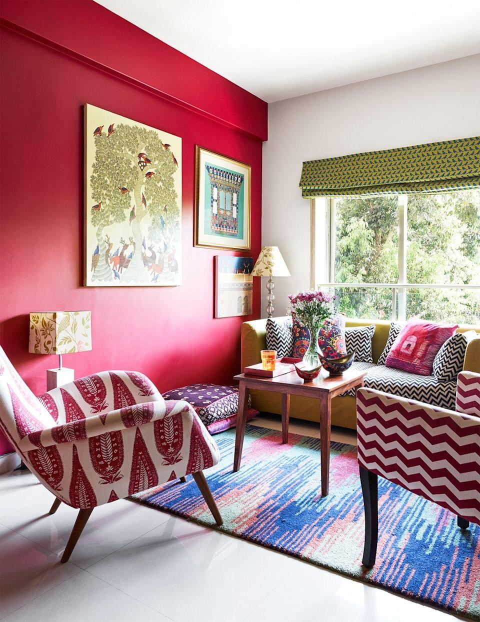 """<p>Pattern packed and bursting with vibrant energy, this living room designed by <a href=""""https://indiacircus.com/"""" rel=""""nofollow noopener"""" target=""""_blank"""" data-ylk=""""slk:Krsnaa Mehta"""" class=""""link rapid-noclick-resp"""">Krsnaa Mehta</a> will inspire you to never hold back when it comes to color. For an especially bold statement, paint an accent wall bright red. </p>"""