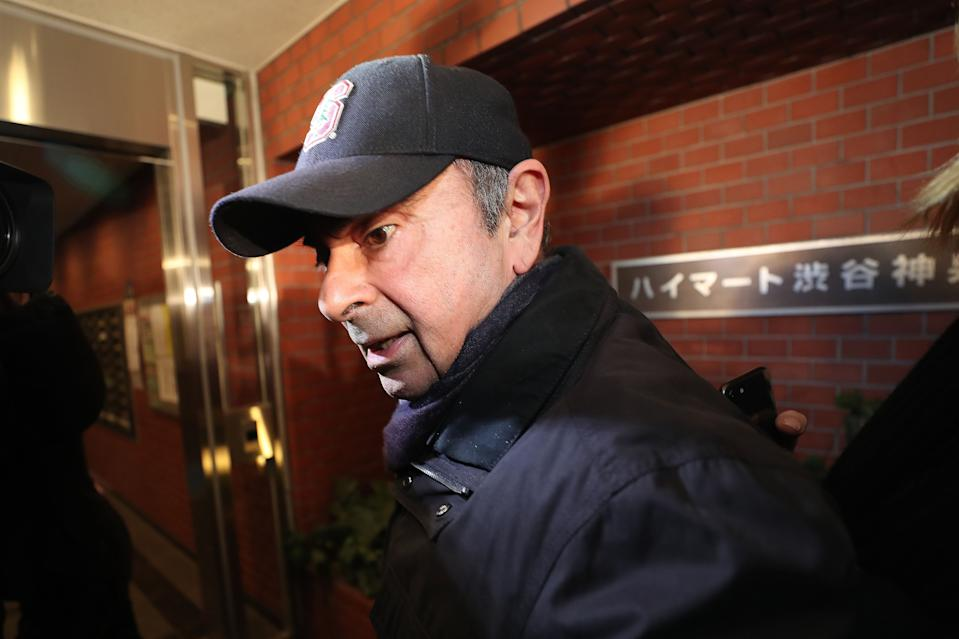 TOPSHOT - Former Nissan chairman Carlos Ghosn arrives at his residence in Tokyo on March 8, 2019. - Ghosn was freed from a Tokyo detention centre on the afternoon of March 6 after his shock arrest on November 19 when Japanese prosecutors stormed into his corporate jet. In keeping with conditions for his bail worth roughly $9 million, Ghosn has promised to live at a residence with surveillance cameras, to stay in Japan, and to use only designated computers with no internet access. (Photo by Behrouz MEHRI / AFP)        (Photo credit should read BEHROUZ MEHRI/AFP via Getty Images)
