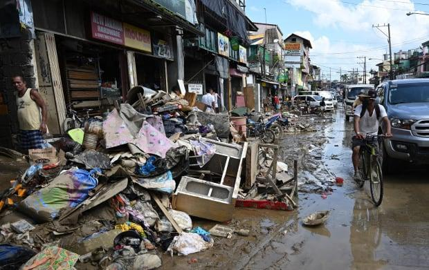 A street in Marikina covered in debris and mud in the aftermath of typhoon-induced flooding and rains on November 13, 2020.