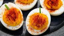 """<p>Don't let the name fool you. This treat gets its fall hue from paprika</p><p><strong><em>Get the recipe at <a href=""""https://www.delish.com/cooking/recipe-ideas/recipes/a44140/pumpkin-deviled-eggs-recipe/"""" rel=""""nofollow noopener"""" target=""""_blank"""" data-ylk=""""slk:Delish"""" class=""""link rapid-noclick-resp"""">Delish</a>. </em></strong></p>"""