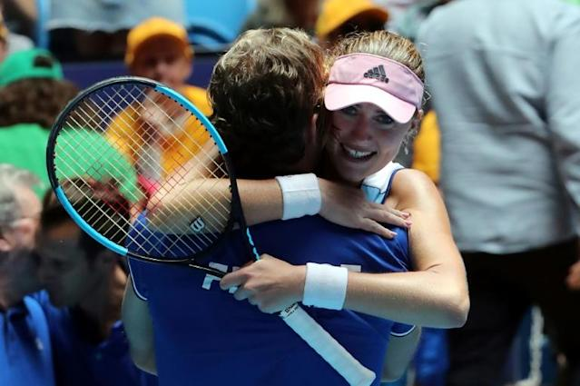 Kristina Mladenovic of France celebrates her victory against Ashleigh Barty of Australia with team's captain Julien Benneteau during the third rubber of the Fed Cup tennis final match between Australia and France in Perth on November 10, 2019. (AFP Photo/Tony Ashby)