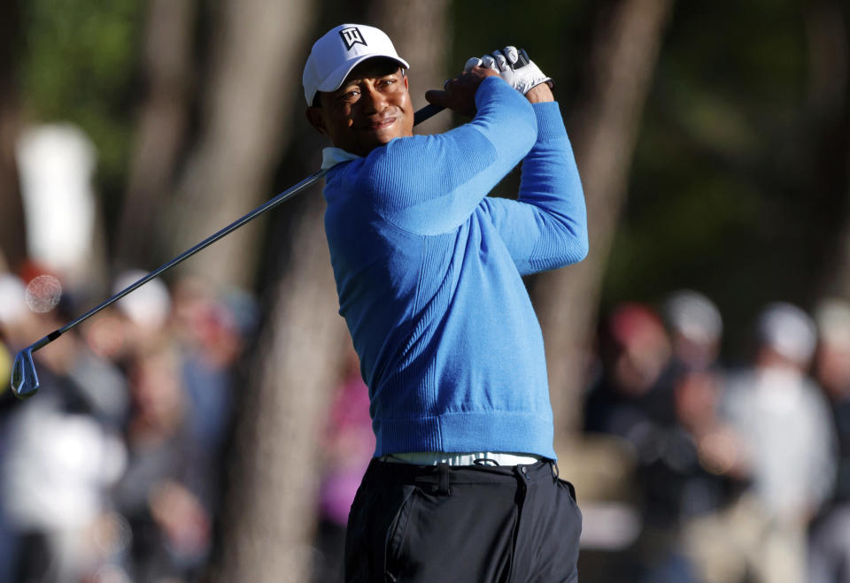 Tiger Woods hits on the 12th hole during the second round of the Valspar Championship golf tournament Friday, March 9, 2018, in Palm Harbor, Fla. (AP Photo/Mike Carlson)