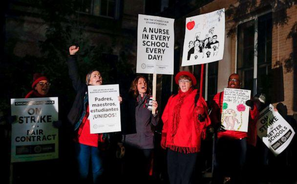 PHOTO: Striking teachers and supporters walk a picket line outside Peirce Elementary School on the first day of strike by the Chicago Teachers Union, Oct. 17 2019 in Chicago. (Kamil Krzaczynski/AFP via Getty Images)