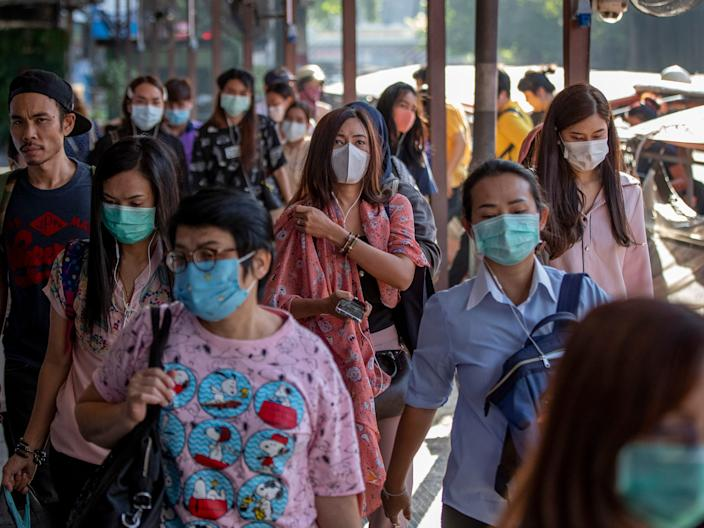 Boat passengers on a jetty wear face masks in Bangkok, Thailand, Tuesday, Jan. 28, 2020 to protect themselves from new virus infection. Panic and pollution drive the market for protective face masks, so business is booming in Asia, where fear of the coronavirus from China is straining supplies and helping make mask-wearing the new normal. (AP Photo/Gemunu Amarasinghe)
