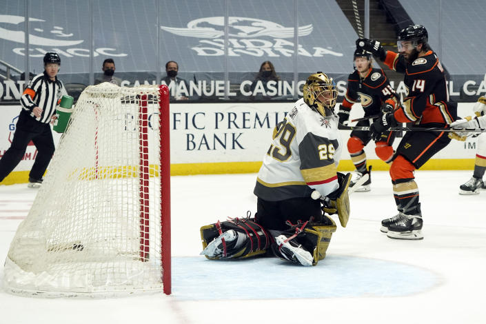 Anaheim Ducks center Adam Henrique (14) celebrates after assisting on a goal from Danton Heinen (not shown) past Vegas Golden Knights goaltender Marc-Andre Fleury (29) during the second period of an NHL hockey game Sunday, April 18, 2021, in Anaheim, Calif. (AP Photo/Marcio Jose Sanchez)