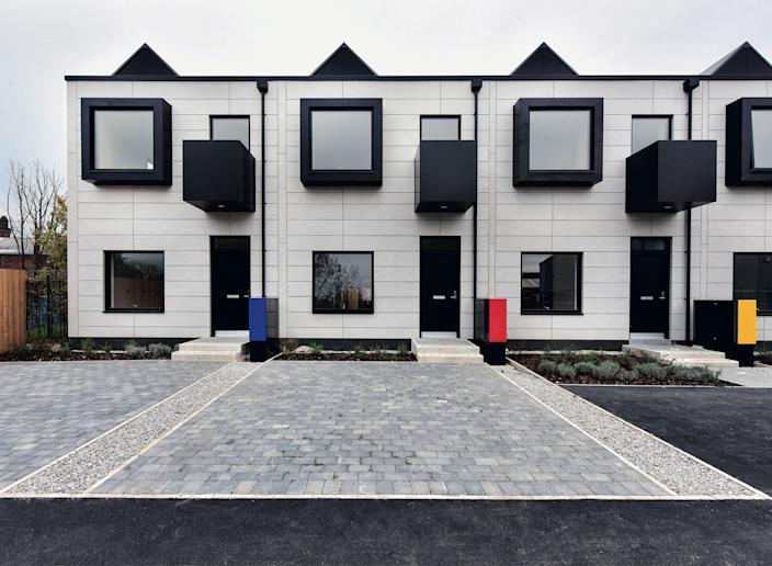 Made up of 36 row houses, the Town House development recalls traditional terrace homes but with a graphic twist: The dwellings, which were designed by ShedKM, can be completed within two to three weeks.