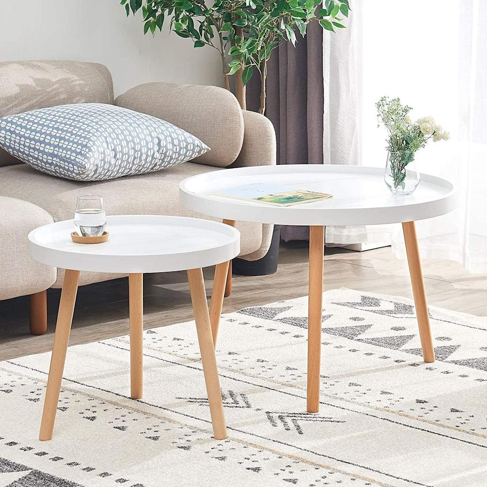 <p>You can use this <span>IBUYKE Coffee Table Set of 2</span> ($100) so many ways.</p>