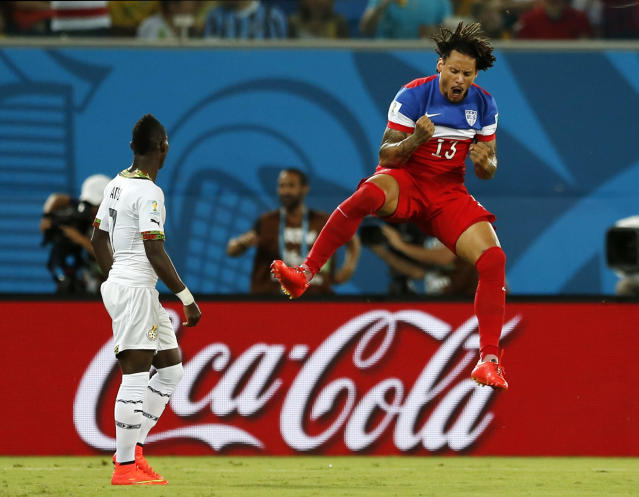 Ghana's Christian Atsu, left, looks back at his net as United States' Jermaine Jones celebrates a goal by Clint Dempsey during the group G World Cup soccer match between Ghana and the United States at the Arena das Dunas in Natal, Brazil, Monday, June 16, 2014. (AP Photo/Julio Cortez)