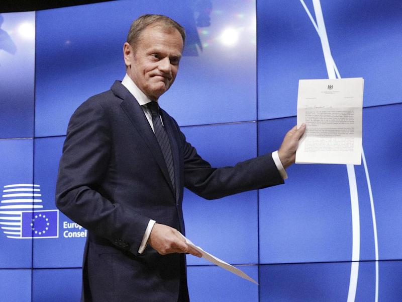 Donald Tusk showing the letter he received signed by Prime Minister Theresa May, which formally notified of the UK's intention to exit the EU (Reuters)
