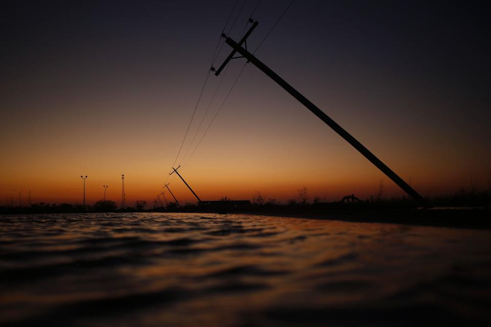 Utility poles felled after Hurricane Delta made landfall in Creole, Louisiana, on Oct. 10, 2020. (Photo: Bloomberg via Getty Images)