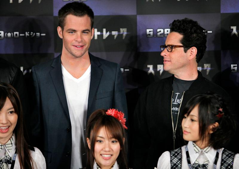 """U.S. director J.J. Abrams, right, and actor of his film """"Star Trek"""" Chris Pine pose with Japanese singing group AKB 48 during a news conference at a Tokyo hotel in Japan Wednesday, May 13, 2009. (AP Photo/Itsuo Inouye)"""