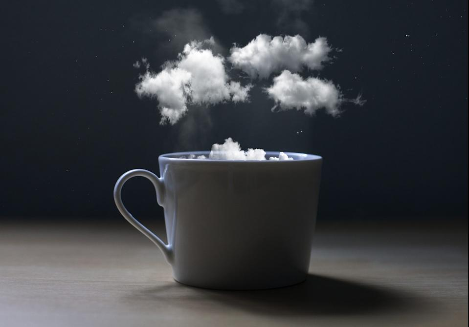 Conceptual photo of a cup with clouds. It seems to say, take a break and dream