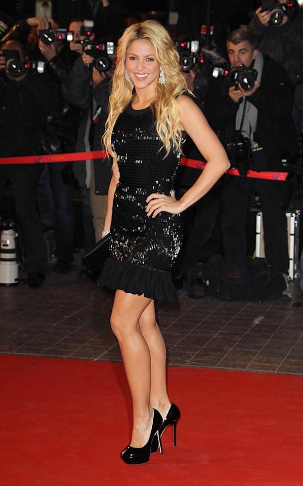 "Shakira has been MIA for the past few months, but the ""She Wolf"" songstress reemerged and rocked the red carpet at the NRJ Music Awards in Cannes, France, in a beautifully beaded Azzedine Alaia Fall 2010 dress, Sergio Rossi pumps, and Lorraine Schwartz jewels. Tony Barson/<a href=""http://www.wireimage.com"" target=""new"">WireImage.com</a> - January 22, 2011"