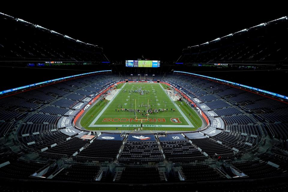 The Denver Broncos and the Tennessee Titans take the field in an empty stadium prior to an NFL football game, Monday, Sept. 14, 2020, in Denver. (AP Photo/Jack Dempsey)