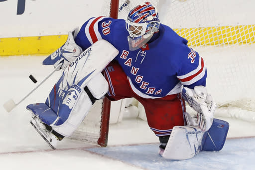 FILE - In this Dec. 27, 2019, file photo, New York Rangers goaltender Henrik Lundqvist makes a save during the third period of the team's NHL hockey against the Carolina Hurricanes in New York. Lundqvist signed with the Washington Capitals when free agency opened Friday, Oct. 9, 2020. (AP Photo/Kathy Willens, File)