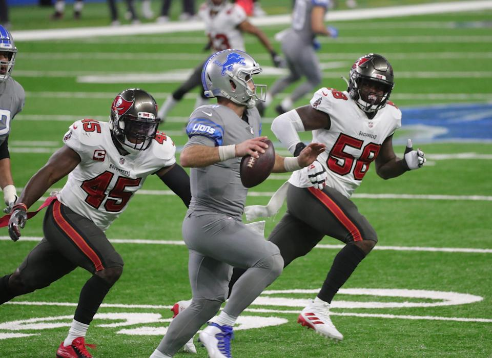 Detroit Lions quarterback Chase Daniel is pursued by Tampa Bay Buccaneers linebacker Devin White (45) and defensive tackle Rakeem Nunez-Roches (56) during the first half Saturday, Dec. 26, 2020 at Ford Field.