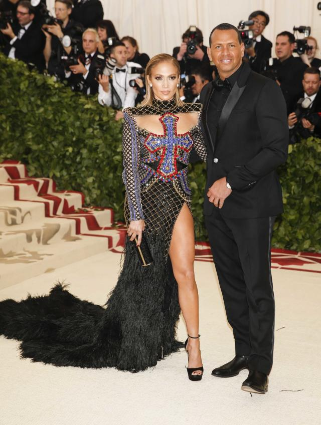"Singer Jennifer Lopez and Alex Rodriguez arrive at the Metropolitan Museum of Art Costume Institute Gala (Met Gala) to celebrate the opening of ""Heavenly Bodies: Fashion and the Catholic Imagination"" in the Manhattan borough of New York, U.S., May 7, 2018. REUTERS/Carlo Allegri"