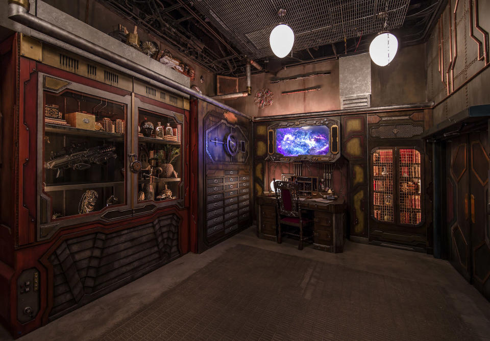 <p>Terran guests are permitted a rare glimpse inside the private office of the Collector. Keen-eyed visitors will spot many a hidden Easter egg among the artificats. (Photo: Disneyland Resort) </p>