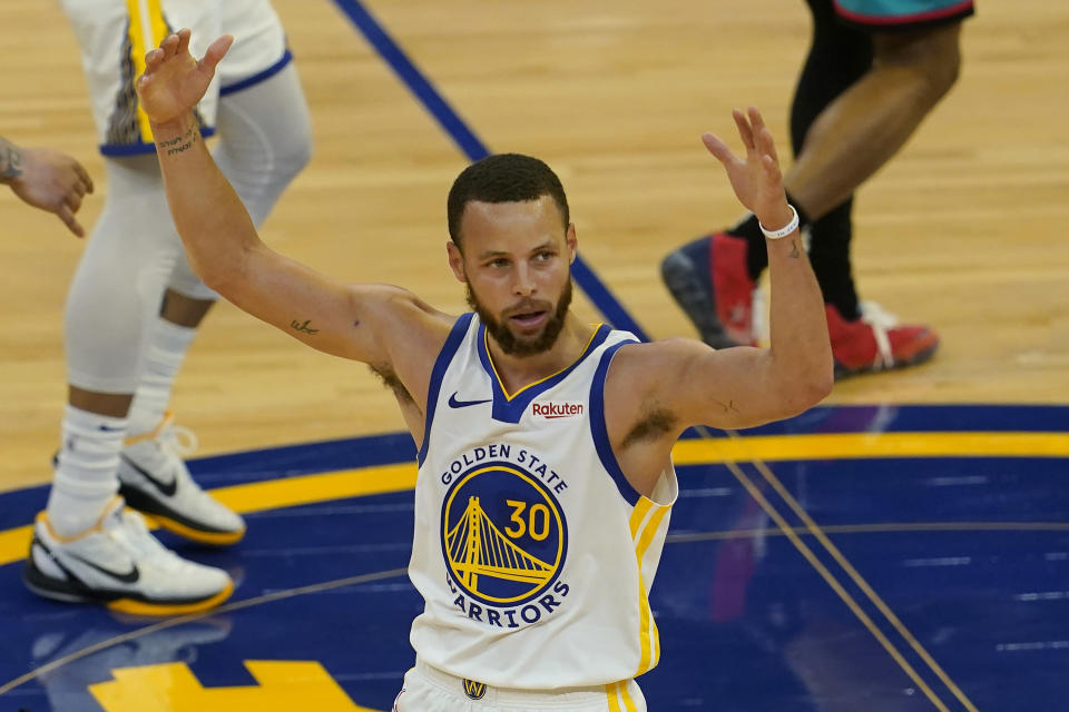 Golden State Warriors guard Stephen Curry (30) reacts after shooting a 3-point basket against the Memphis Grizzlies during the second half of an NBA basketball game in San Francisco, Sunday, May 16, 2021. (AP Photo/Jeff Chiu)