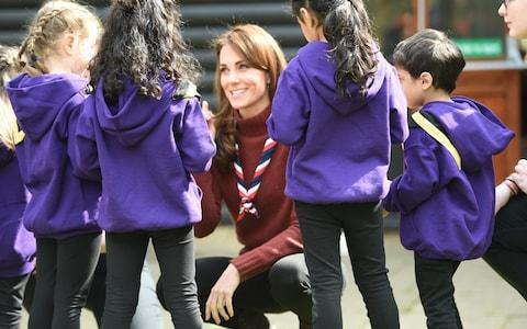 The Duchess speaks with young scouts - Credit: Eddie Mulholland For The Telegraph