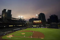 Smoke from California wildfires mixes with low clouds as the San Diego Padres play the Colorado Rockies in a baseball game at Petco Park Wednesday, Sept. 9, 2020, in San Diego. (AP Photo/Gregory Bull)