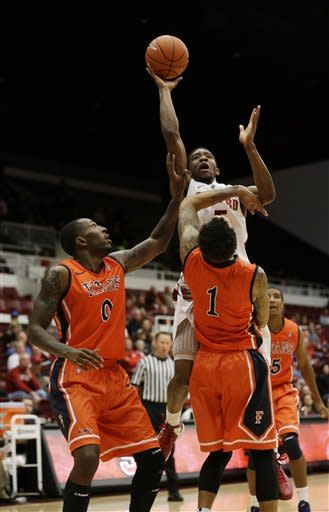 Stanford guard Chasson Randle (5) shoots over Cal State Fullerton forward Marquis Horne (0) and guard Jared Brandon (1) during the first half of an NCAA college basketball game in Stanford, Calif., Monday, Nov. 12, 2012. (AP Photo/Marcio Jose Sanchez)