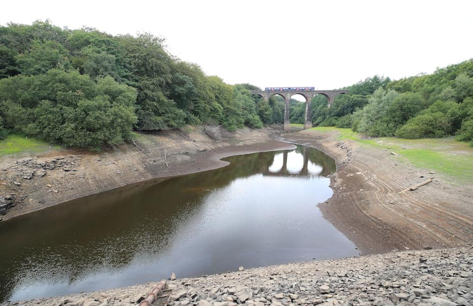 The heatwave has caused searing temperatures and a lack of rainfall, leading to a depleted Wayoh reservoir, near Bolton (PA)