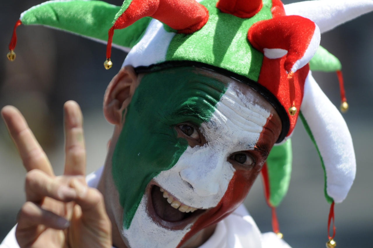 An Italian soccer fan cheers for his team ahead of the Euro 2012 soccer championship final match between Spain and Italy in Kiev, Ukraine, Sunday, July 1, 2012. (AP Photo/Sergei Chuzavkov)