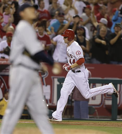 Los Angeles Angels' Mark Trumbo rounds the bases after his three run rome run off Seattle Mariners starting pitcher Felix Hernandez during the fifth inning of a baseball game in Anaheim, Calif., Thursday, June 20, 2013. (AP Photo/Chris Carlson)