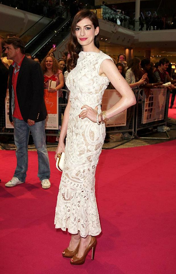 """Anne Hathaway kept it classy in a tea-length ivory Alexander McQueen gown at the London premiere of  """"One Day."""" (08/23/2011)"""