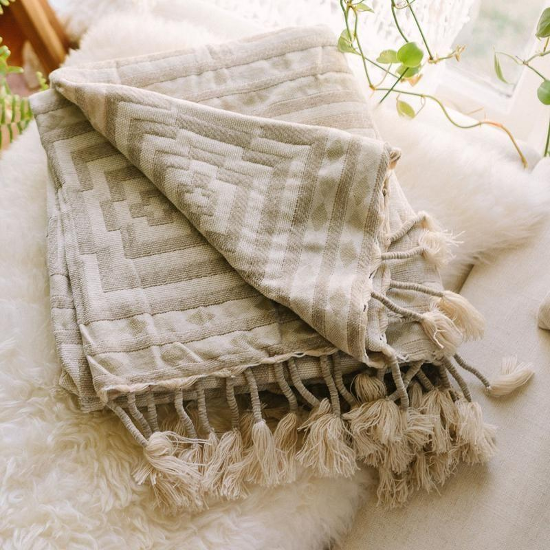 """<p><strong>Jungalow</strong></p><p>jungalow.com</p><p><strong>$99.00</strong></p><p><a href=""""https://www.jungalow.com/products/hypnotic-throw-blanket-by-justina-blakeney"""" rel=""""nofollow noopener"""" target=""""_blank"""" data-ylk=""""slk:Shop Now"""" class=""""link rapid-noclick-resp"""">Shop Now</a></p><p>Maybe you're not into the all-encompassing slipcover look, and that's okay! Just spread a gorg throw blanket, like this Jungalow pick, over your couch, and <em>v</em><em>oilà!</em></p>"""