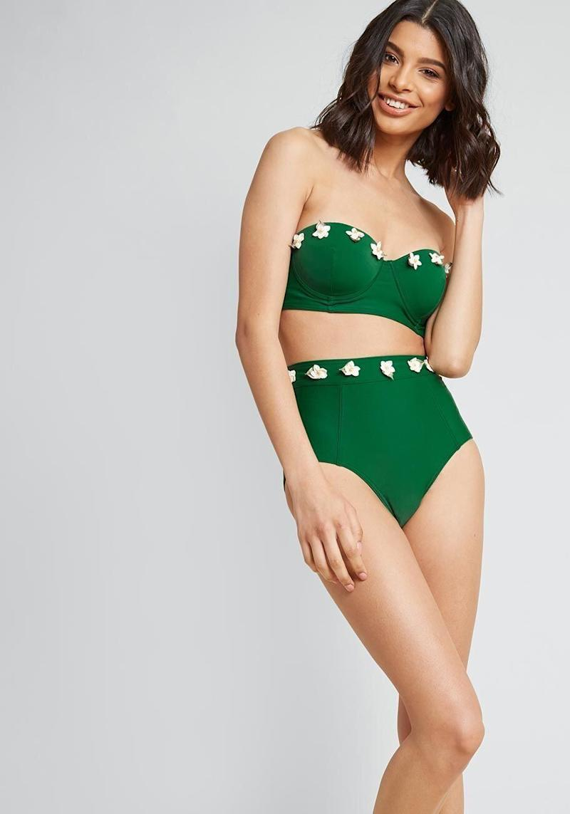 "<strong>Get the <a href=""https://www.modcloth.com/shop/swimwear/on-island-time-bustier-bikini-top-in-green/159031.html"" target=""_blank"" rel=""noopener noreferrer"">bustier top</a> for $55 and <a href=""https://www.modcloth.com/shop/swimwear/on-island-time-high-waisted-bikini-bottom-in-green/159030.html"" target=""_blank"" rel=""noopener noreferrer"">the bottoms</a> for $45.</strong>"