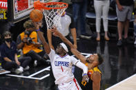 Los Angeles Clippers guard Reggie Jackson (1) goes to the basket as Utah Jazz center Rudy Gobert, right, defends during the second half of Game 5 of a second-round NBA basketball playoff series Wednesday, June 16, 2021, in Salt Lake City. (AP Photo/Rick Bowmer)