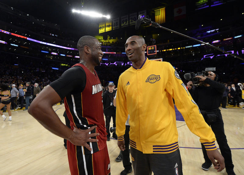 LOS ANGELES, CA - MARCH 30: Kobe Bryant #24 of the Los Angeles Lakers gets together with Dwyane Wade #3 of the Miami Heat after the basketball game at Staples Center March 30, 2016, in Los Angeles, California. NOTE TO USER: User expressly acknowledges and agrees that, by downloading and or using the photograph, User is consenting to the terms and conditions of the Getty Images License Agreement. (Photo by Kevork Djansezian/Getty Images)