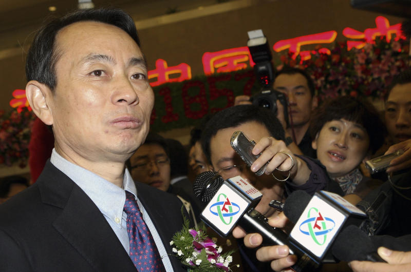 In this Monday, Nov. 5, 2007 photo, Jiang Jiemin, chairman of PetroChina, left, is mobbed by journalists after attending an IPO ceremony for PetroChina at the Shanghai Stock Exchange in Shanghai. Chinese authorities announced an investigation into the head of a commission that oversees China's state-owned companies in the country's latest high-profile corruption case. The Ministry of Supervision said in a brief statement Sunday, Sept. 1, 2013 that Jiang Jiemin, director of the Cabinet's Assets Supervision and Administration Commission, is being investigated over suspected serious disciplinary violations. The vague term is often shorthand in official Chinese announcements for allegations of corruption by a government official or manager of a state company. (AP Photo) CHINA OUT
