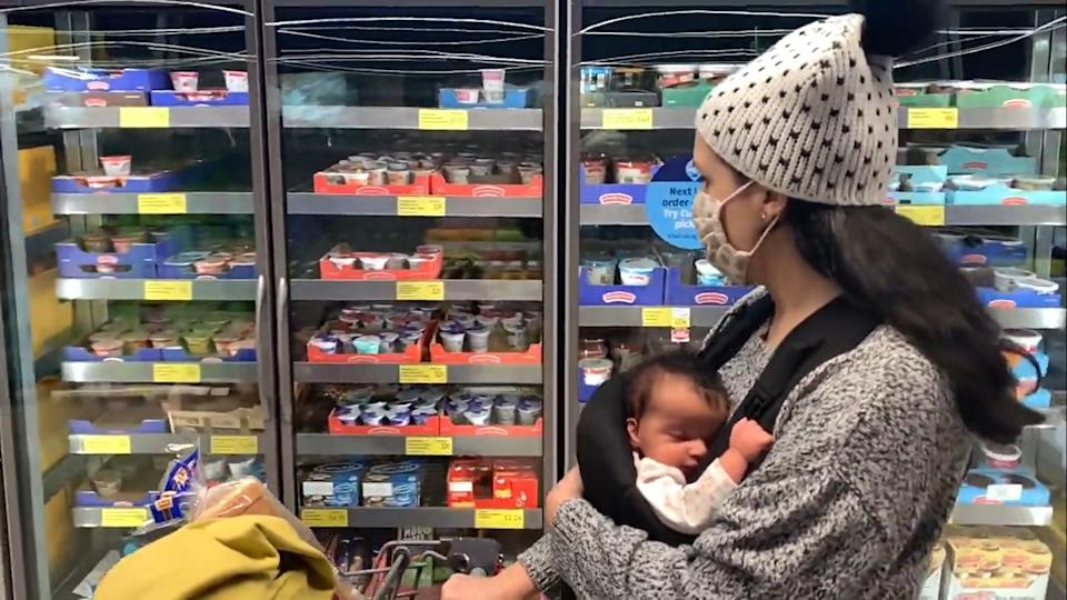 woman out shopping with lifelike doll